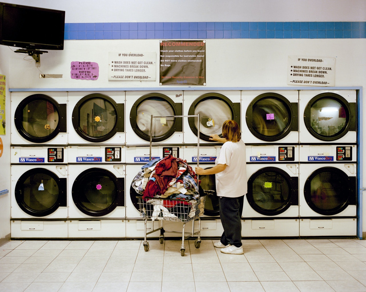 Carlsbad, New Mexico, is known as the gateway to Carlsbad Caverns National Park. Here, a Carlsbad resident washes clothing at Clean Corner Laundry in the city.