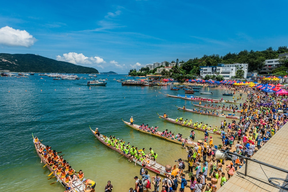 Racers line up to row at a Hong Kong dragon boat contest.