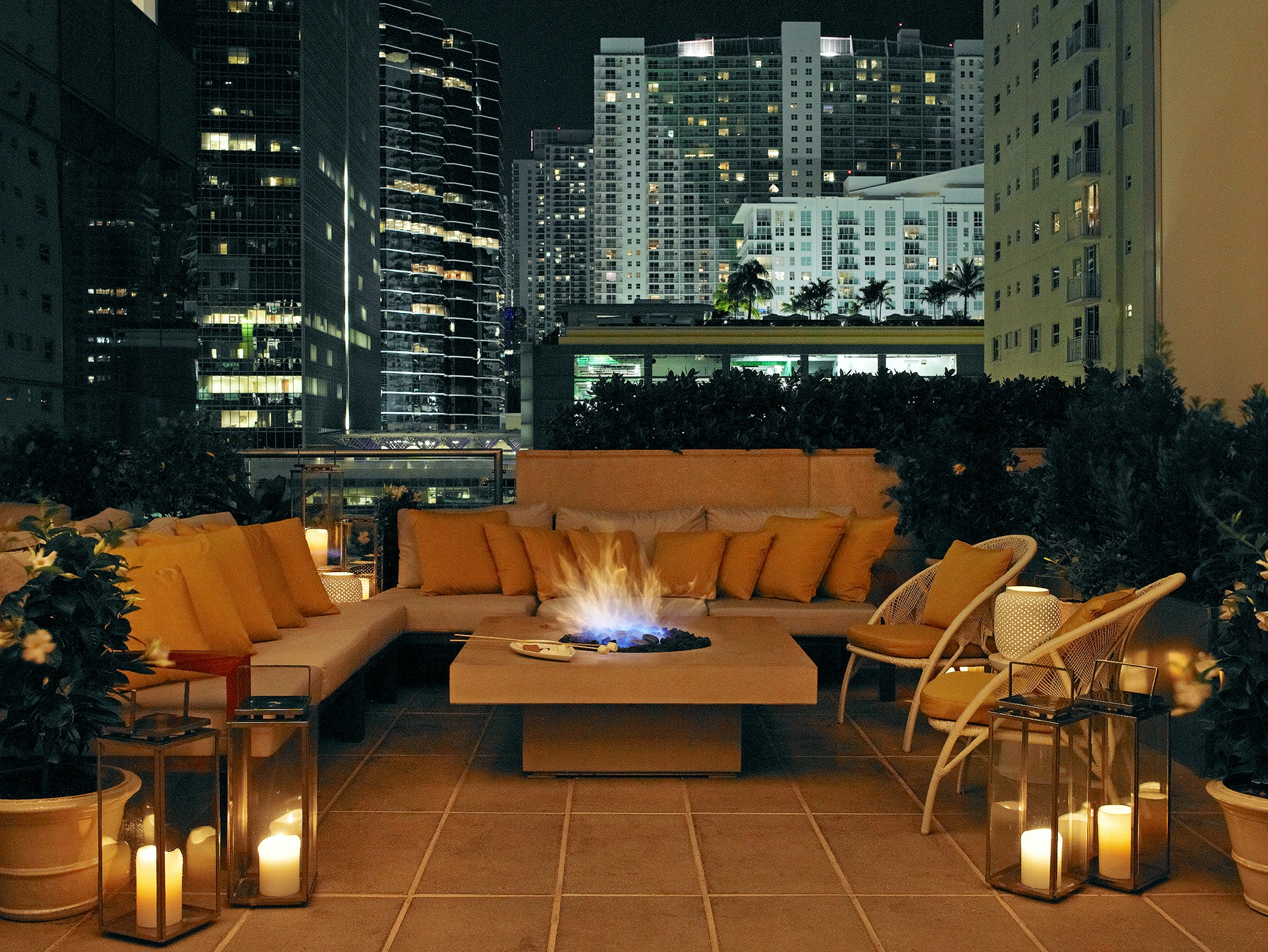 Cozy up by the fire pits on the seventh-floor Edge Terrace at the Four Seasons Hotel Miami.