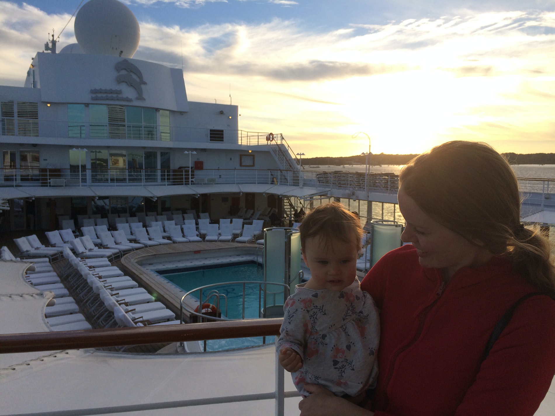 The author and her daughter, Madeleine, on the pool deck of the Seven Seas Navigator.