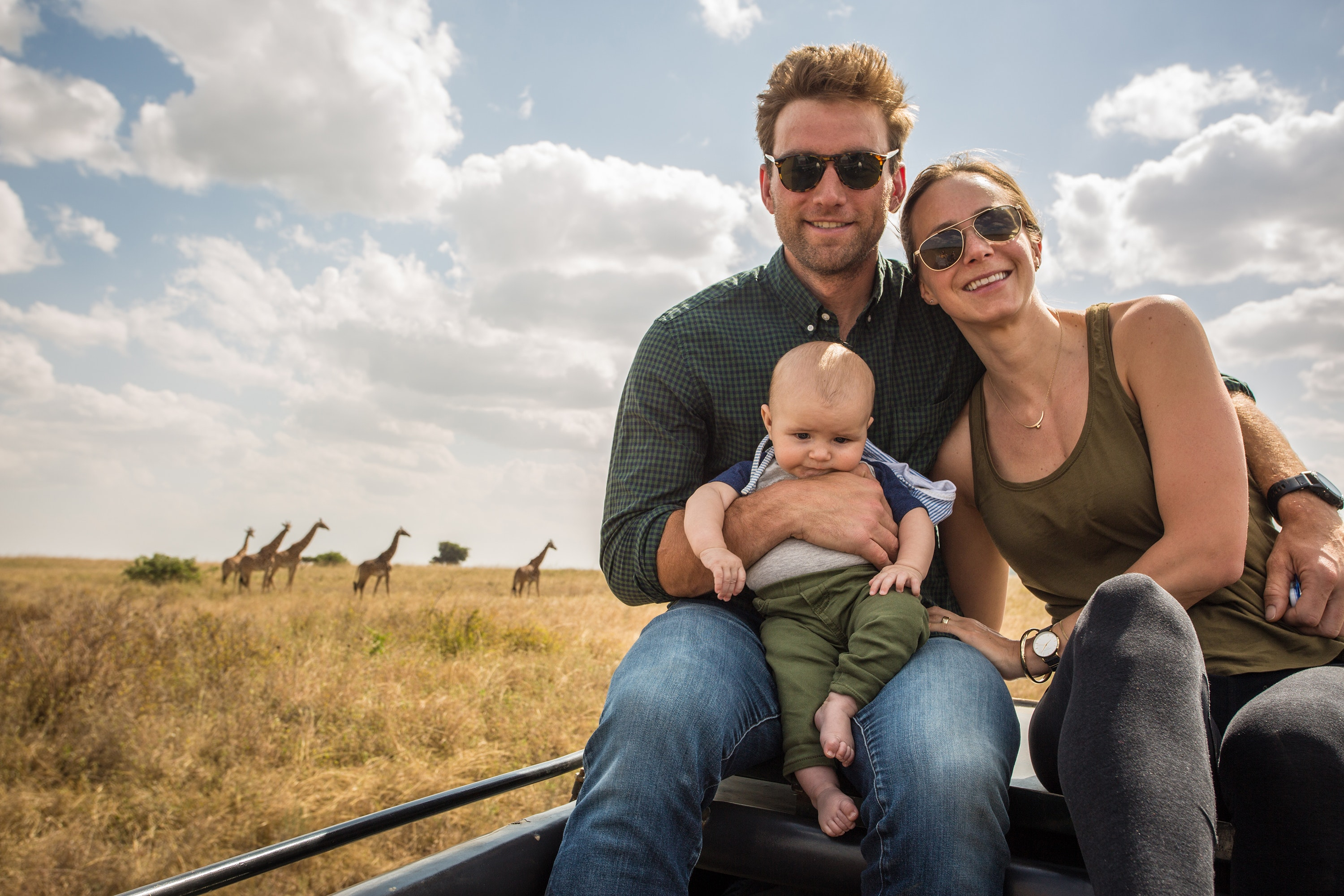 The Chambers's young son, Max, is already an old hand at navigating Africa. Here, the trio poses while on a brief wildlife safari in Nairobi National Park.