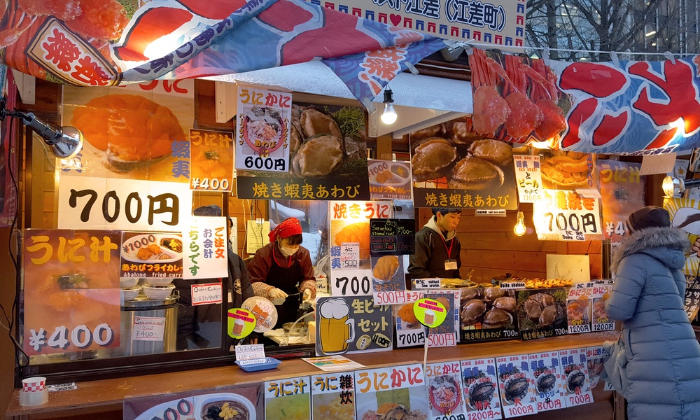 Street vendors sell local fare like crab in Hokkaido.