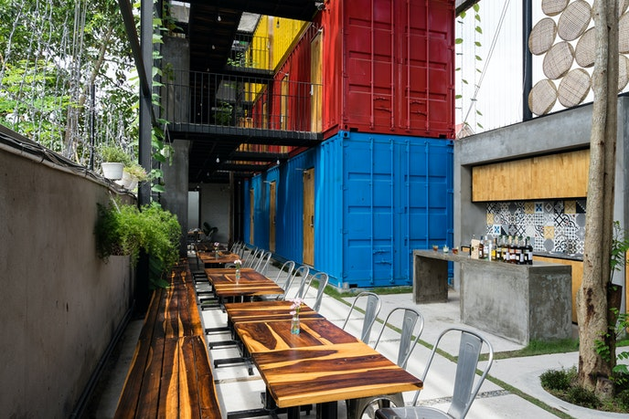 CCASA Hostel integrates recycled shipping containers and reclaimed wood windows.