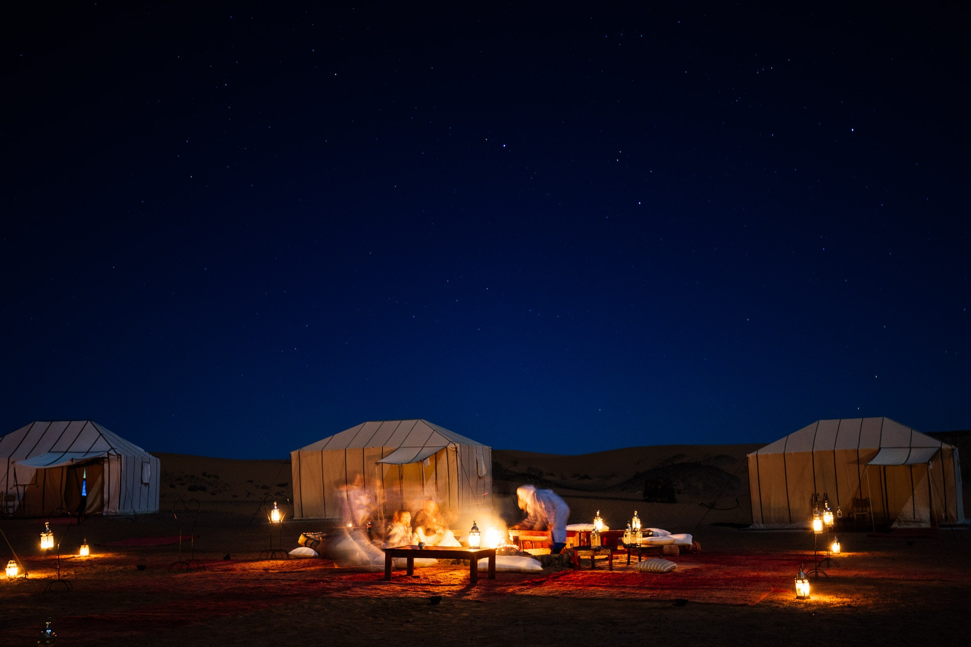 "Sipping mint tea (""Moroccan whiskey"") and sharing stories under the stars. During our visit, the moon was nearly full, allowing us to explore the dunes at night."