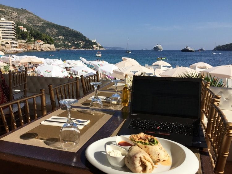 A typical Remote Year work setup: Looking out over a Dubrovnik beach.