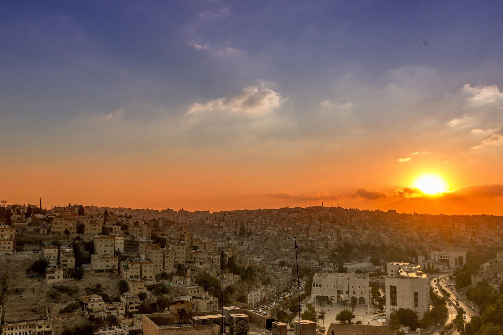 Jordan's capital city, Amman, is home to both modern buildings and ancient ruins.