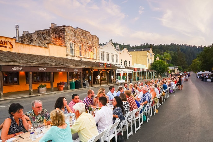 Diners gather on Calistoga's main street during the Harvest Table event in 2017.