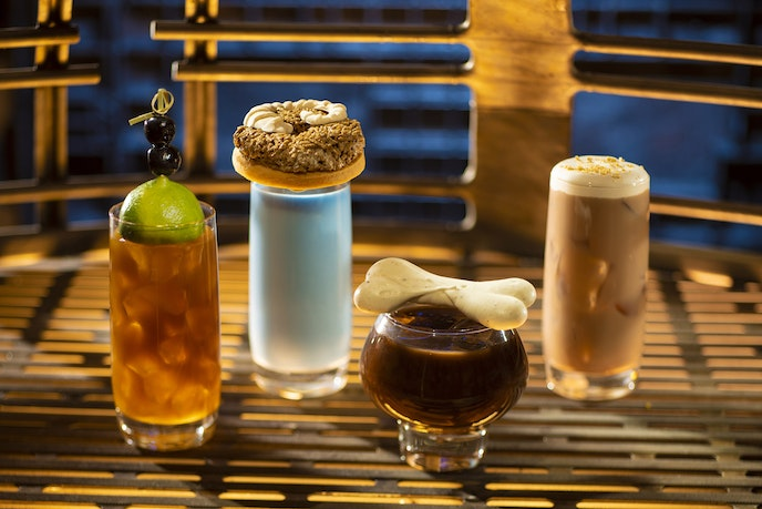 Garnishes are as important as the drinks themselves at Oga's Cantina, as demonstrated by the zero-proof Blue Bantha Milk (middle left) and the boozy Bloody Rancor (middle right).