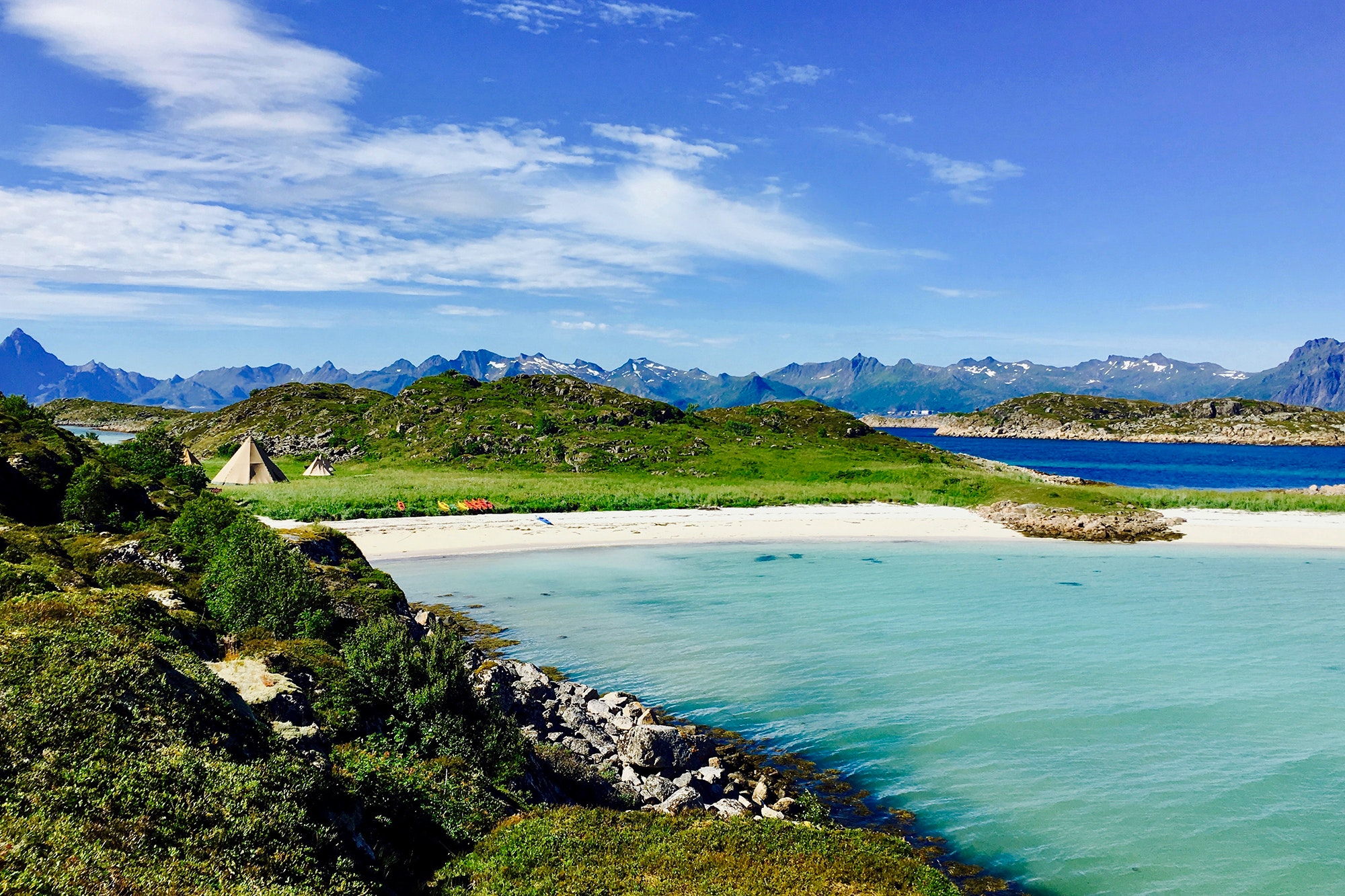 Enjoy the midnight sun from a beach in the Lofoten Islands.