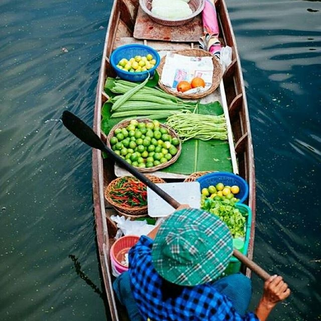 Getting an early morning start at the floating market in Bangkok.