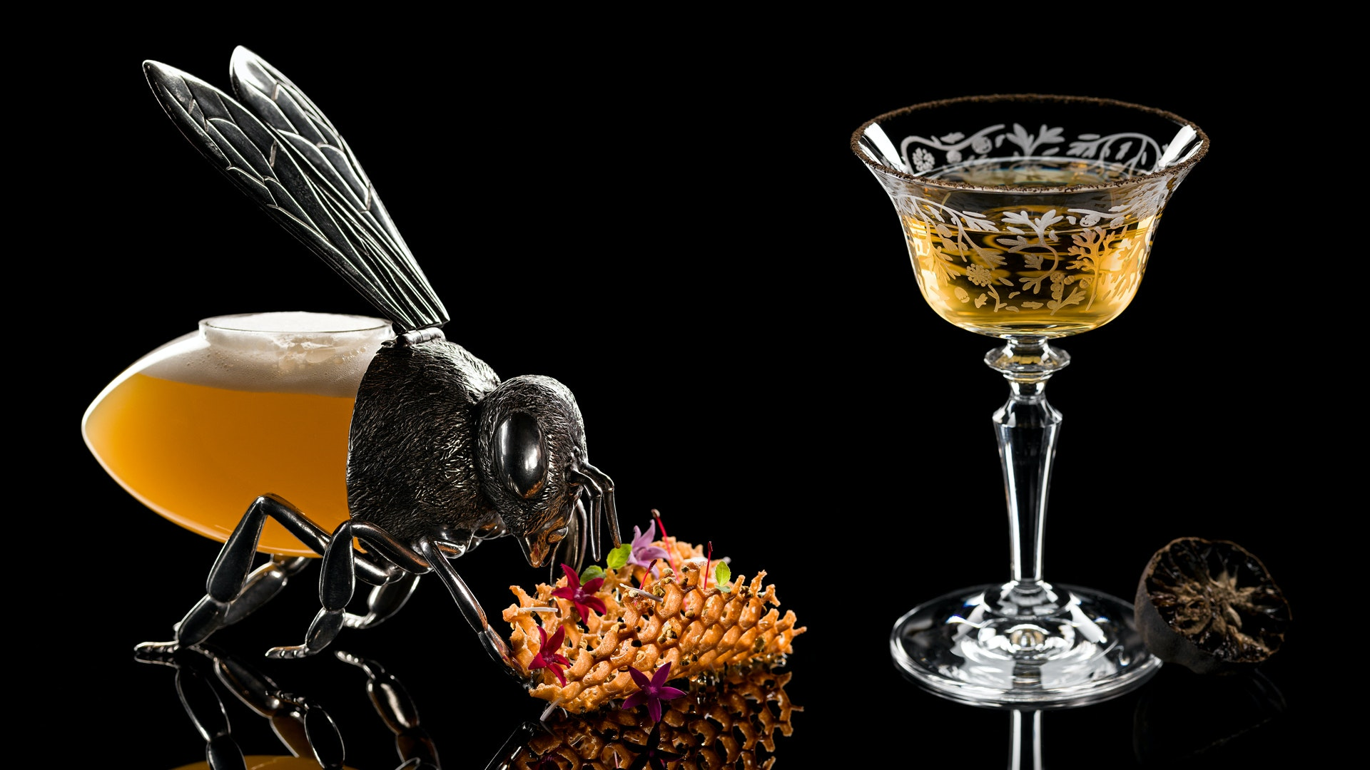 """Nektar"" is presented in a bee-shaped glass; inspired by the Silk Road, ""Cyrus"" features vodka, Iranian black lemon powder, and Lillet, a wine-based citrus aperitif."