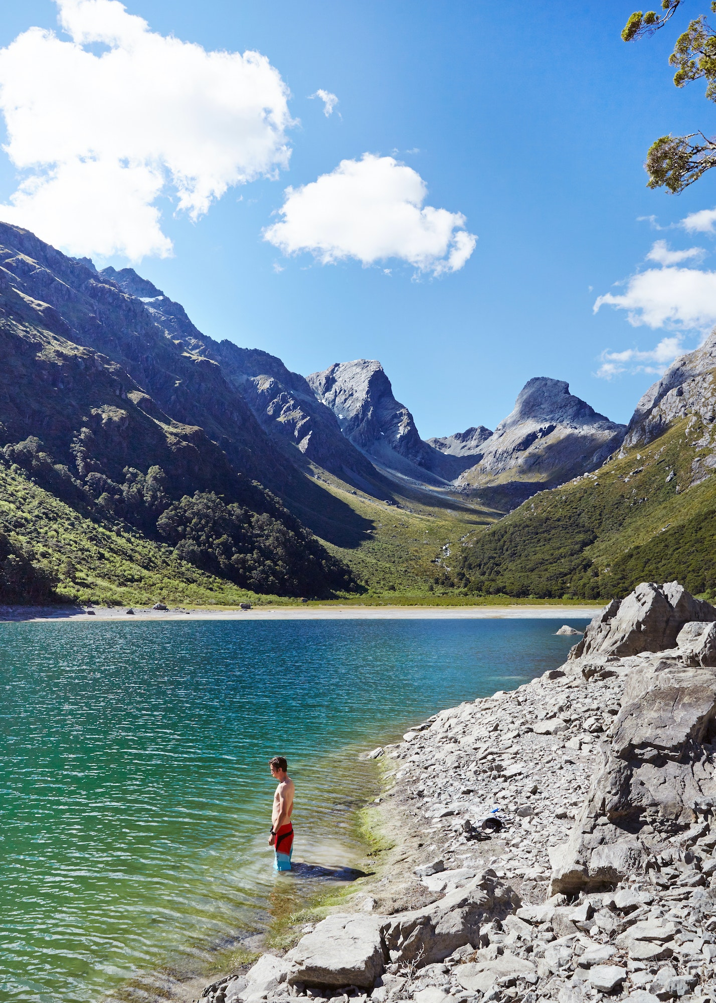 The Routeburn Track weaves through meadows, reflective tarns, and alpine lakes, linking Mount Aspiring National Park with Fiordland National Park.