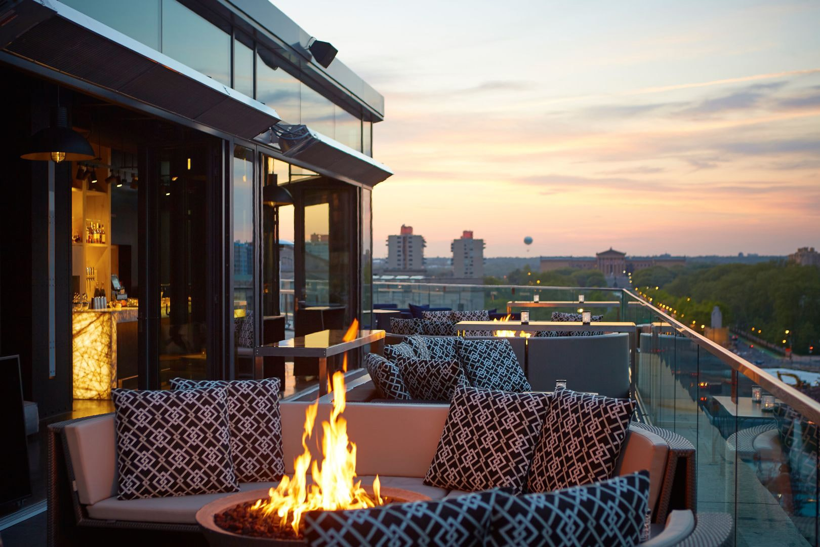 Settle in next to The Logan's rooftop fire pit after a day of taking in the fall colors at Philadelphia's green spaces.