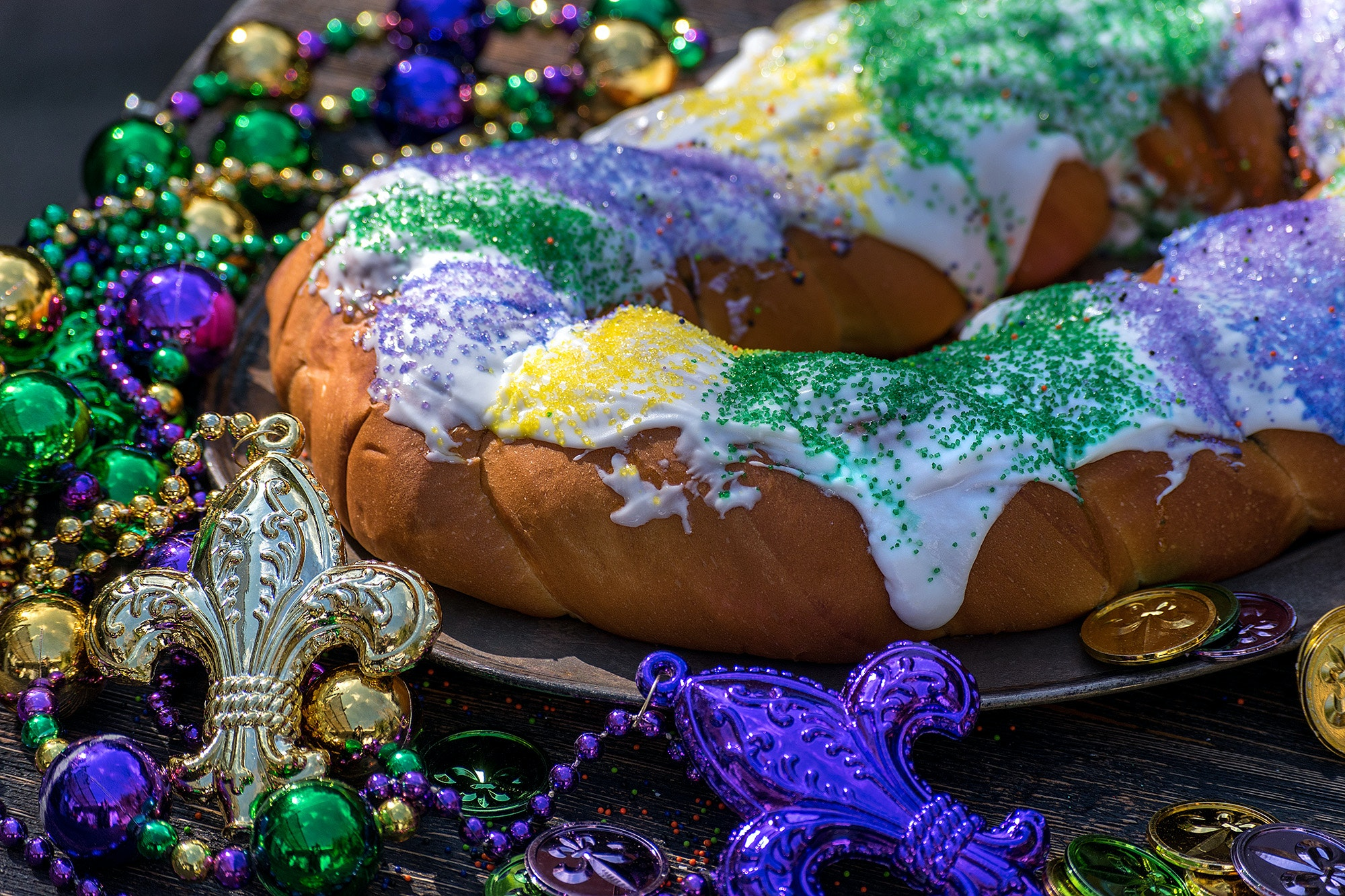 A traditional New Orleans–style king cake