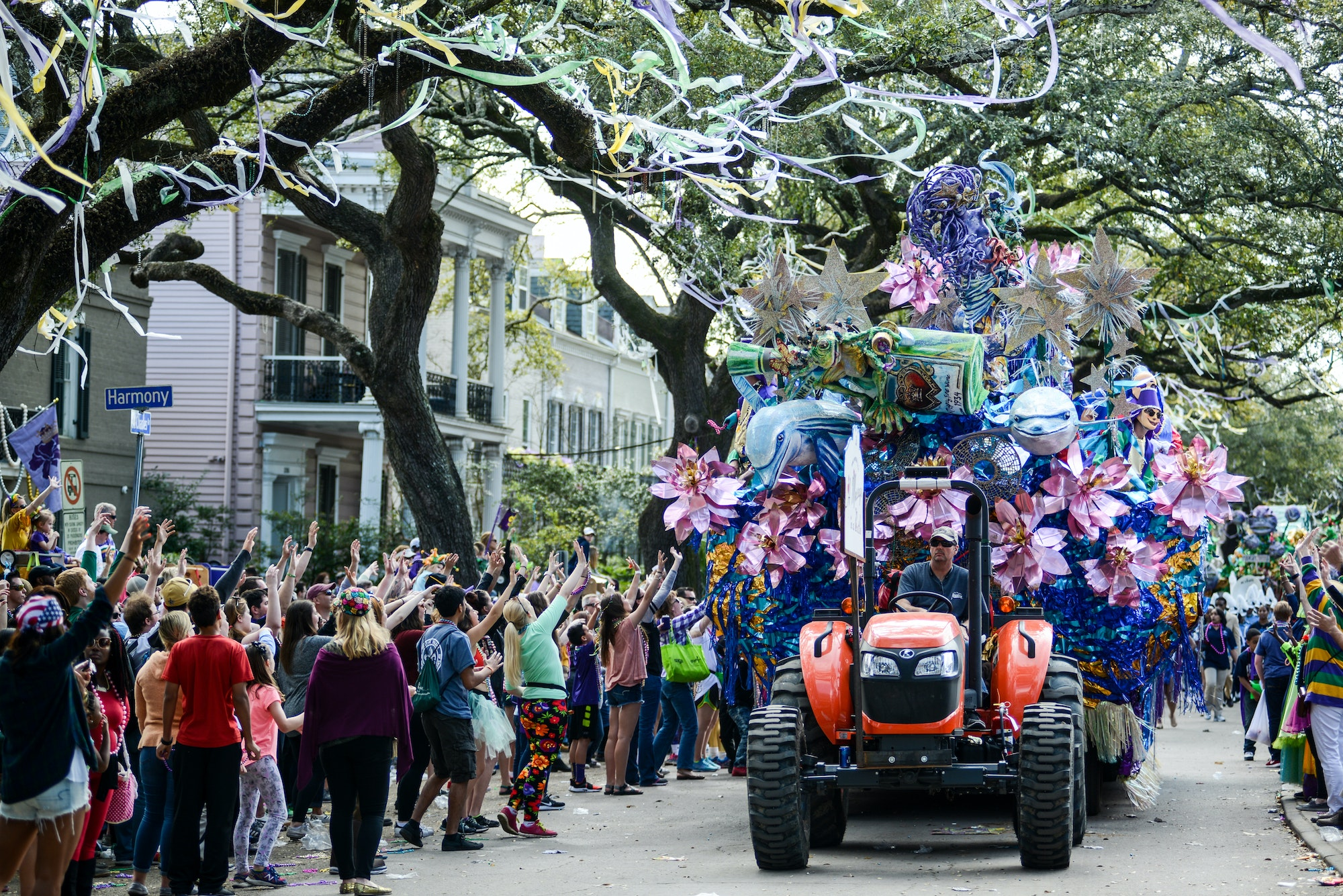 A float for a Mardi Gras parade rolls down St. Charles Avenue in New Orleans.