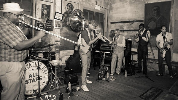 With its mission to protect traditional New Orleans jazz, Preservation Hall is a cornerstone of the city's music and culture.