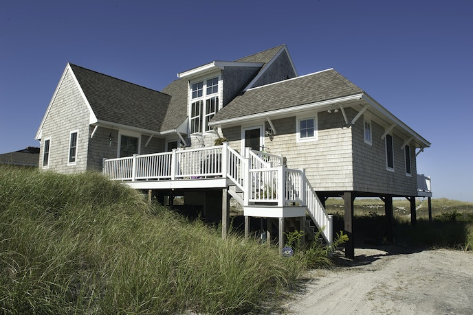 Invite your friends to rent the extra unit in this beach house so you can take over the whole property.