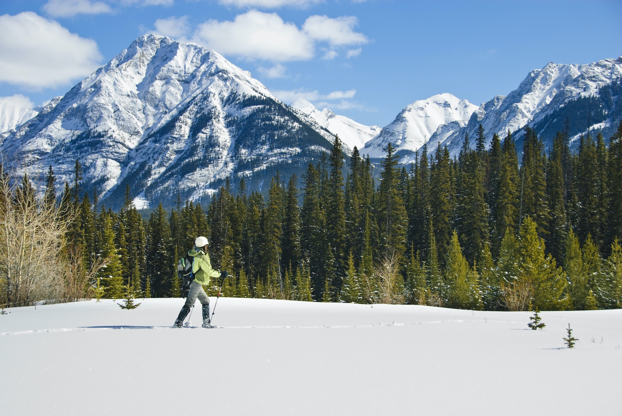 When Banff's ski slopes crowd up during winter, activities like snowshoeing offer more solitude.