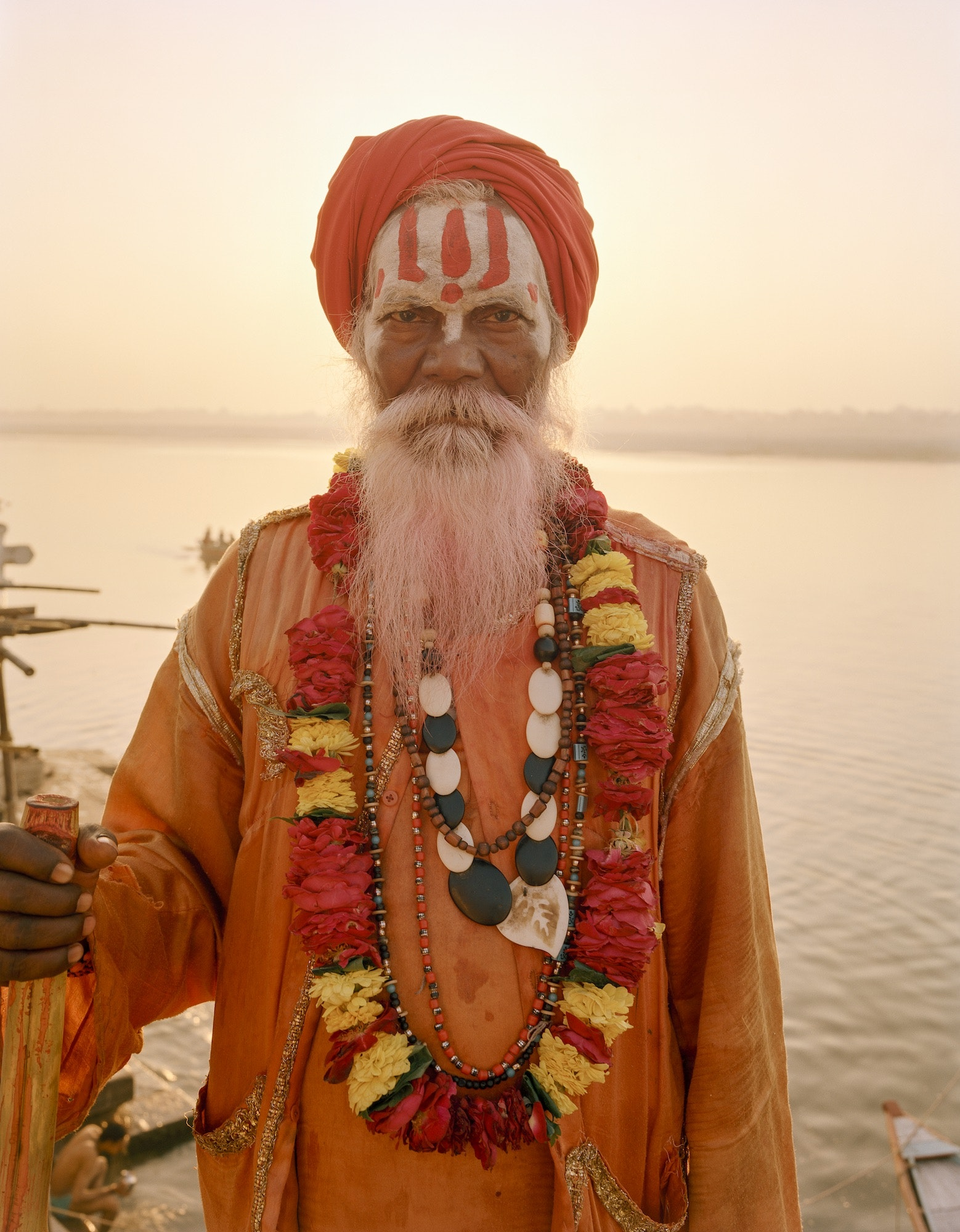A sadhu (holy man) poses for a photo on the banks of the Ganges River.