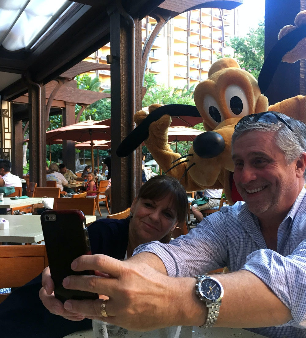 The author's parents indulging in a selfie with Pluto