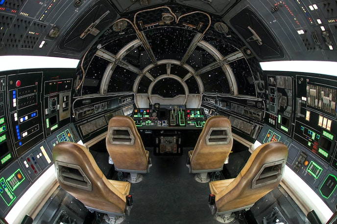 """""""Millennium Falcon: Smugglers Run"""" puts parkgoers in control of the ride by letting them pilot, defend, or repair the fastest hunk of junk in the galaxy."""