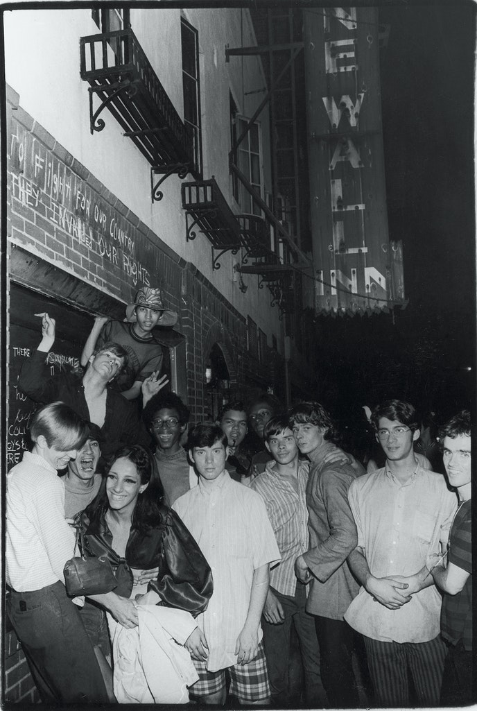 Young people gather outside the Stonewall Inn on the night of the riots, June 28, 1969.