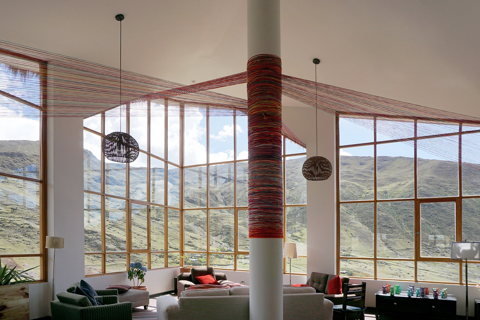 The common room at the Huacahuasi Lodge is an ideal place to get lost in a mountain daydream.