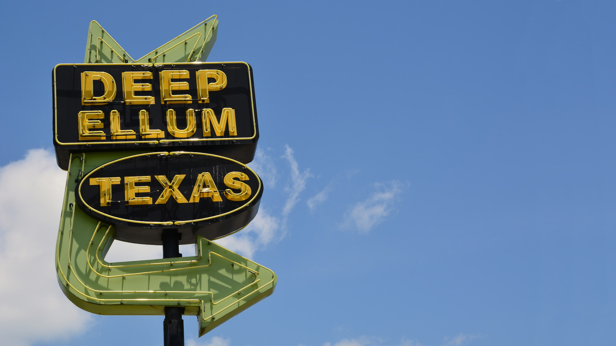 A retro sign marks this trendy Dallas neighborhood.