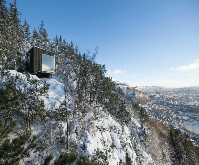 """Local design students conceptualized """"Tubakuba,"""" a design-forward wooden hut situated high above the Norwegian city of Bergen."""