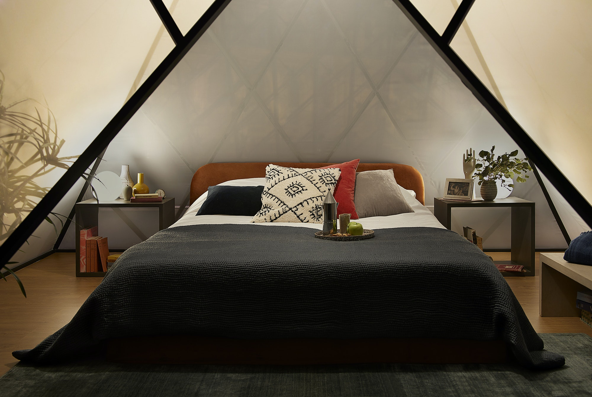Inside the mini-pyramid bedroom at the Louvre