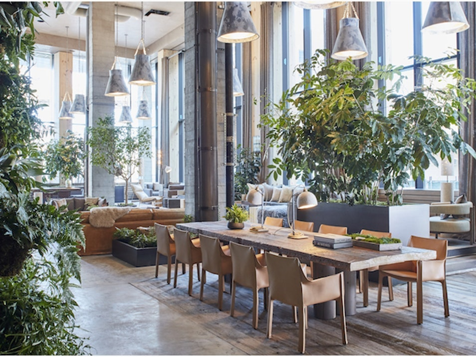 Natural materials, from concrete columns to untreated wood, dominate the aesthetic at 1 Hotel Brooklyn Bridge.