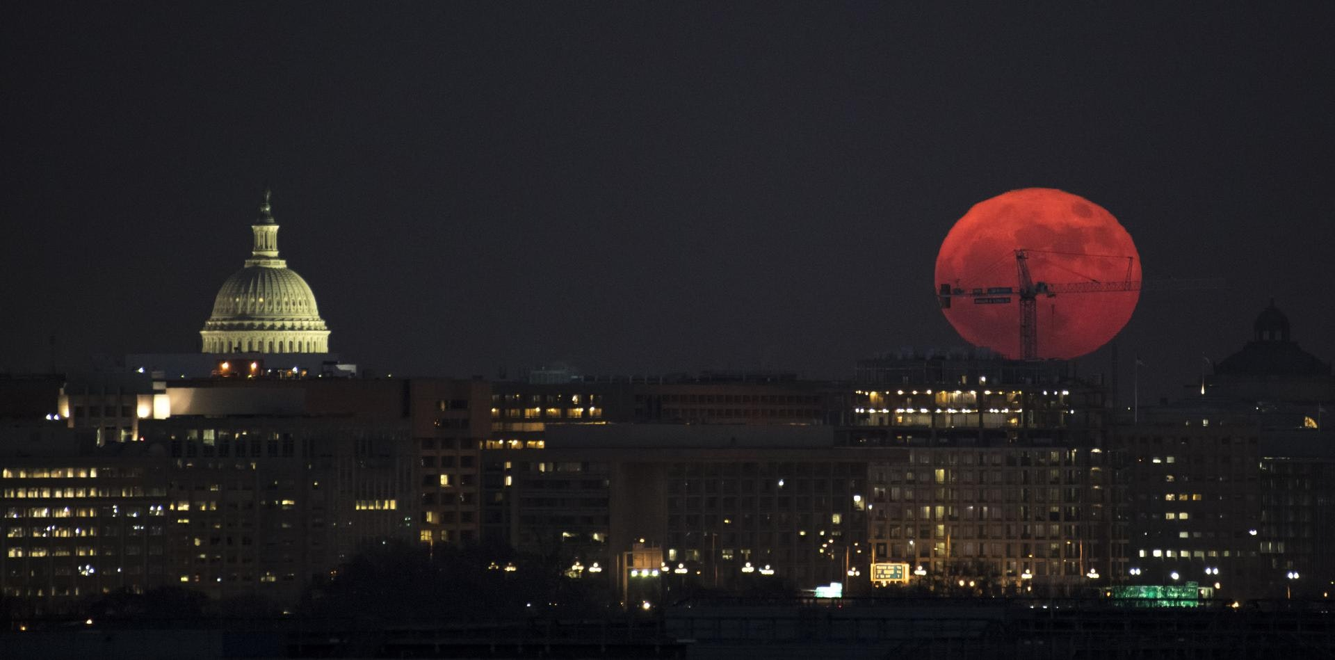The supermoon rises over the U.S. Capitol on December 3, 2017.