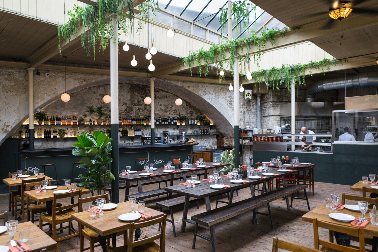 Inside the light and airy dining room at Caso do Frango