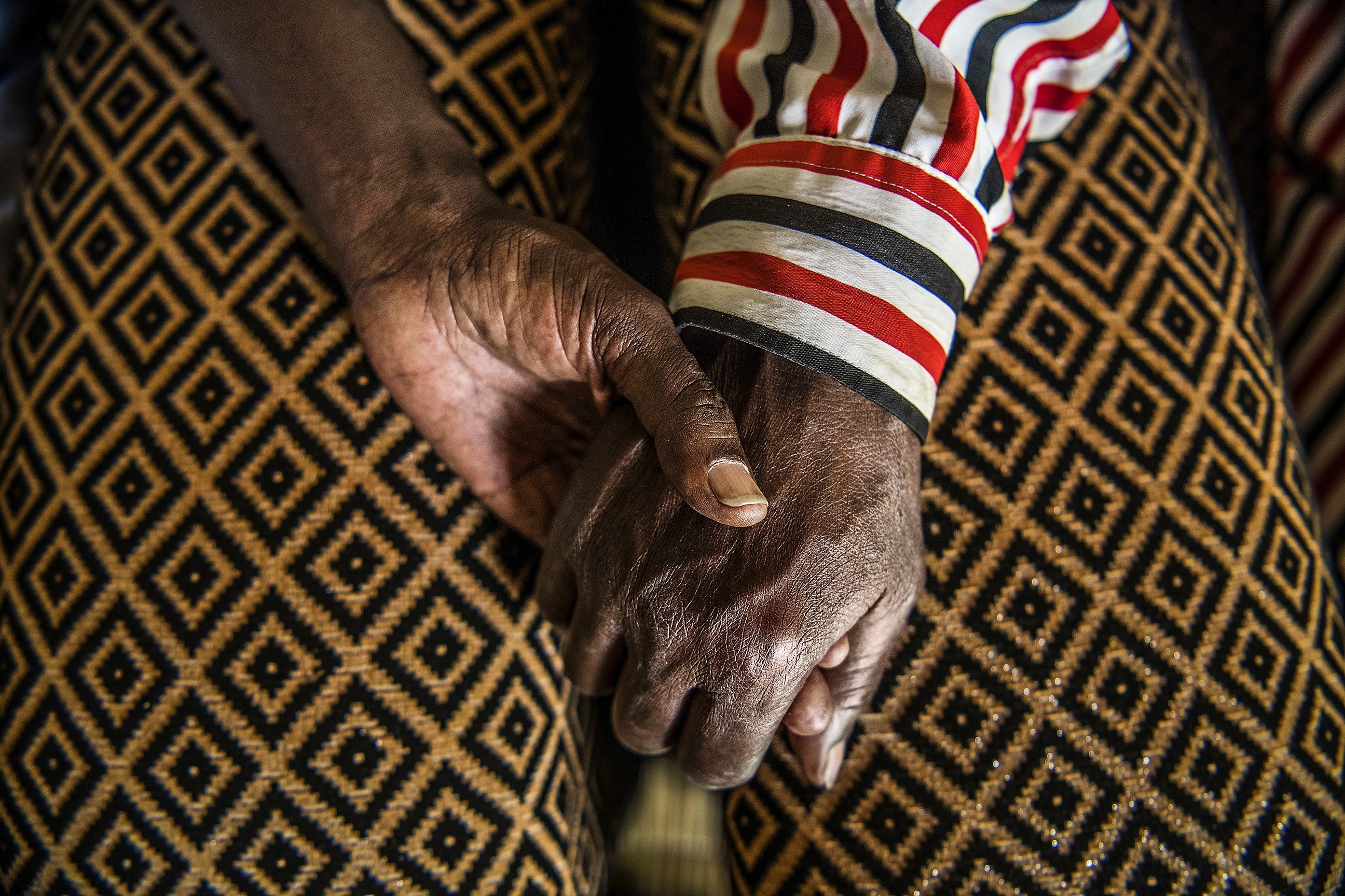 The hands of Aloys Mutiribambe in Mbyo reconciliation village