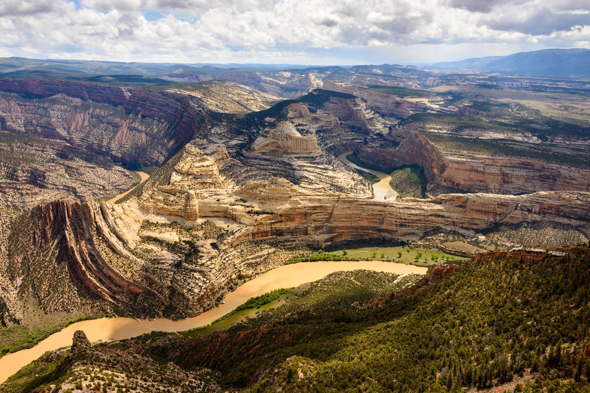 Dinosaur National Monument offers archaeological remains and stunning canyon views.