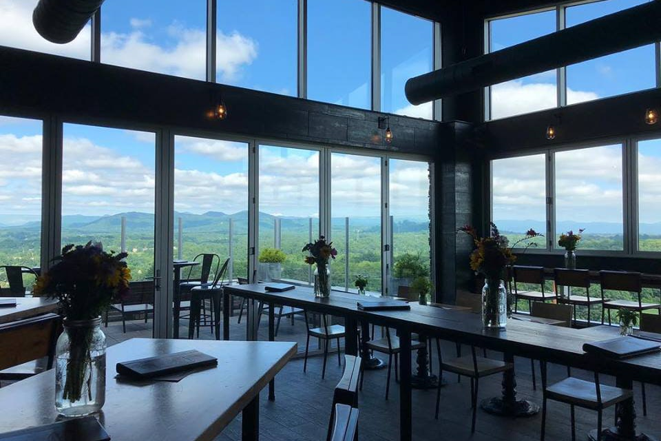 The Montford's floor-to-ceiling windows display views of Asheville's Blue Ridge Mountains.