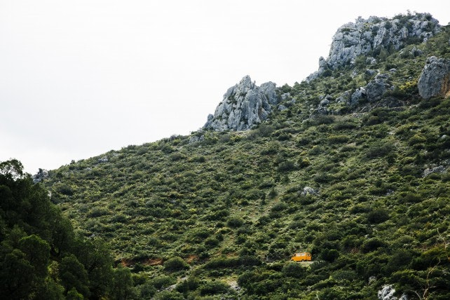 A bus traveling on the road through the Rif Mountains