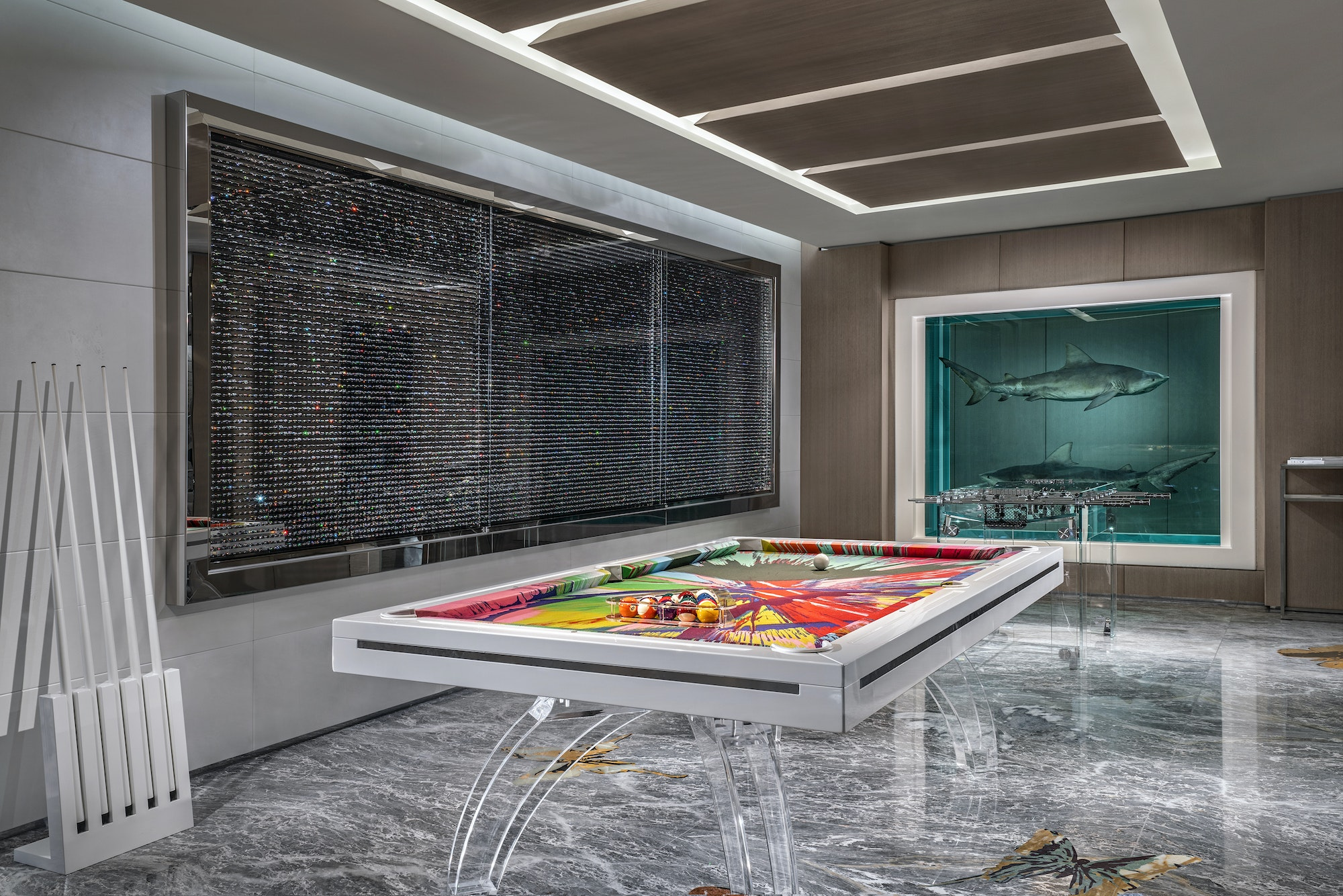 A diamond-filled pill cabinet sets the scene in the game room.