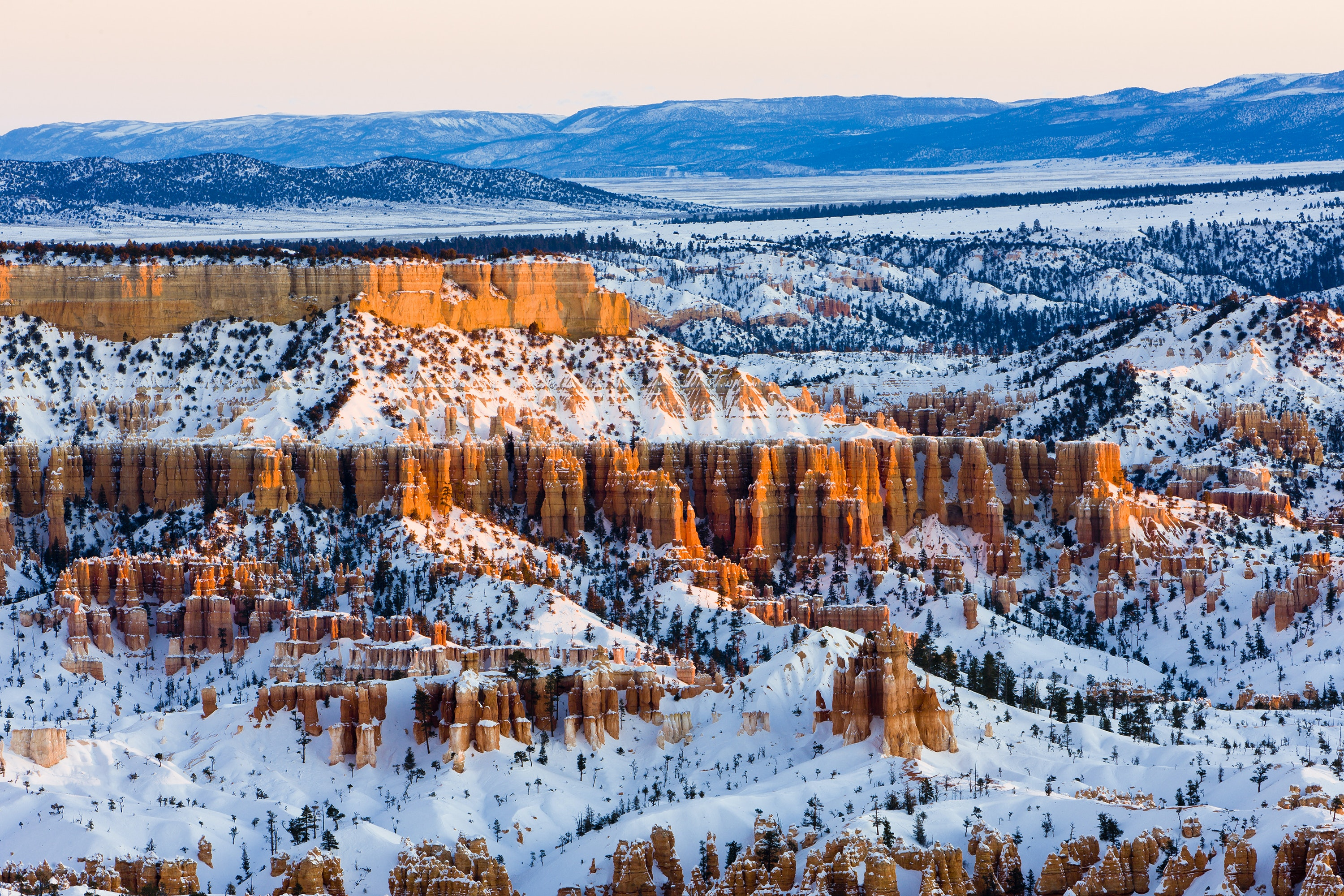 Explore the hoodoos of Bryce Canyon on snowshoes in the winter.