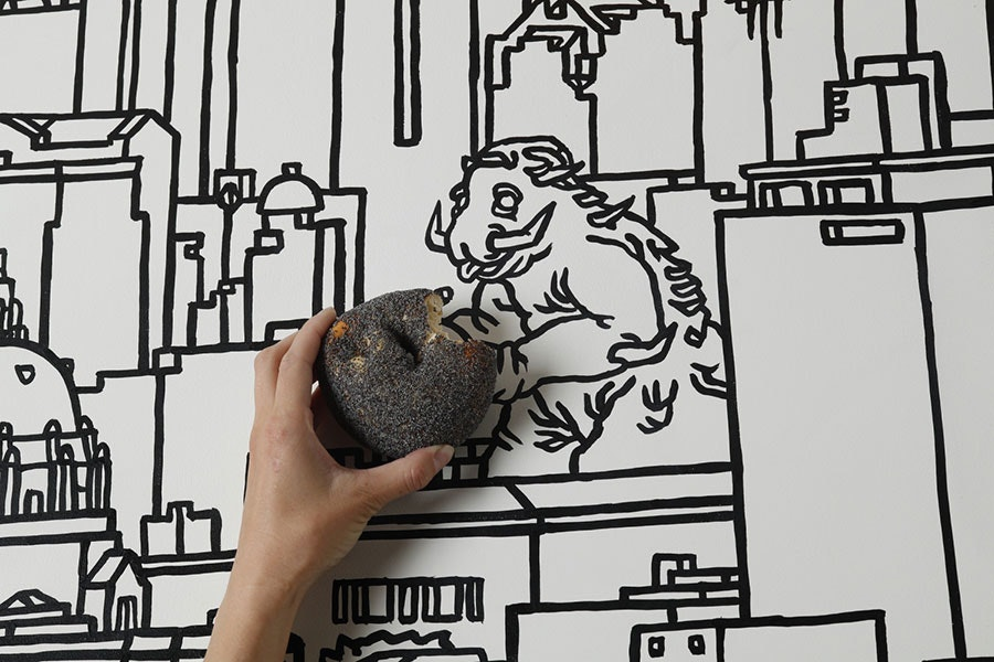 A mural on the wall at Wise Sons Tokyo depicts San Francisco in front of Mount Fuji (and inserts a certain monster among the buildings).
