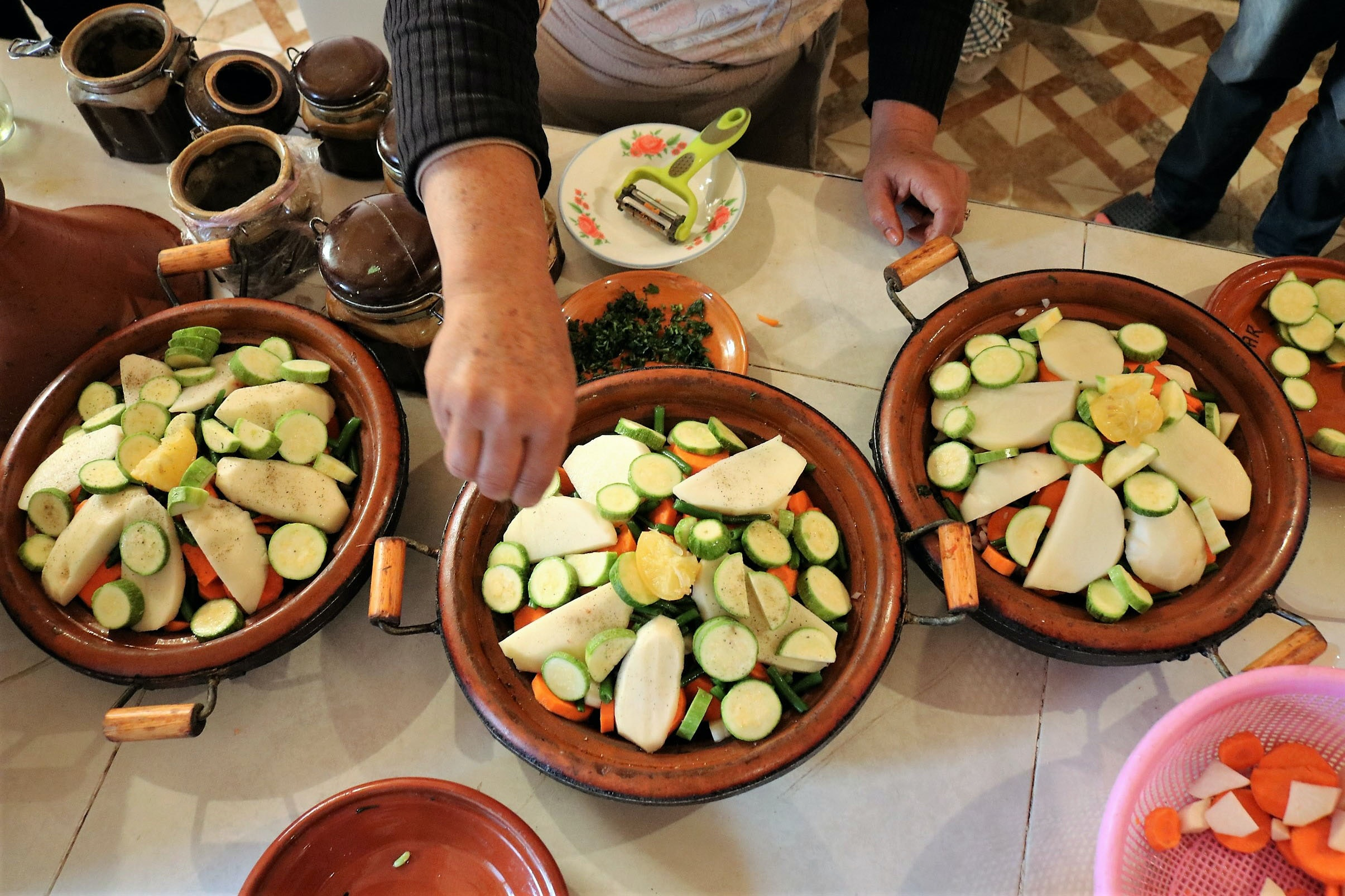 At a cooking demonstration at Riad Dar Tagine, students learned to heap vegetables onto meat inside earthenware tagines.