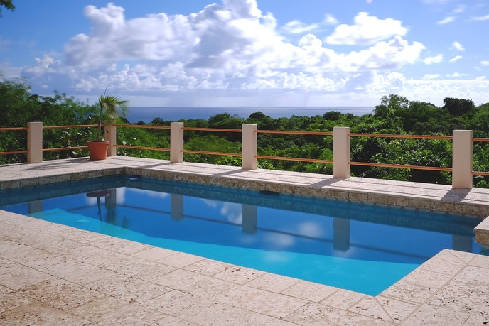 Enjoy the ocean views from the pool at this Puerto Rico Airbnb.