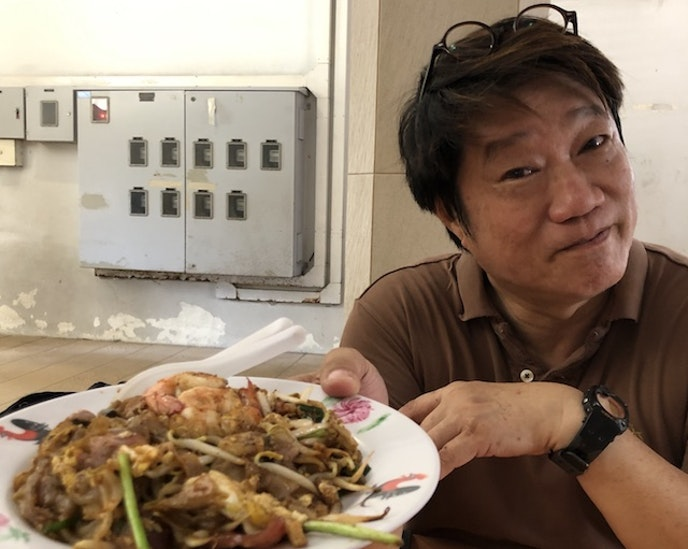 """KF Seetoh presenting a plate of """"char kway teow"""" noodles, Old Airport Road Food Centre"""