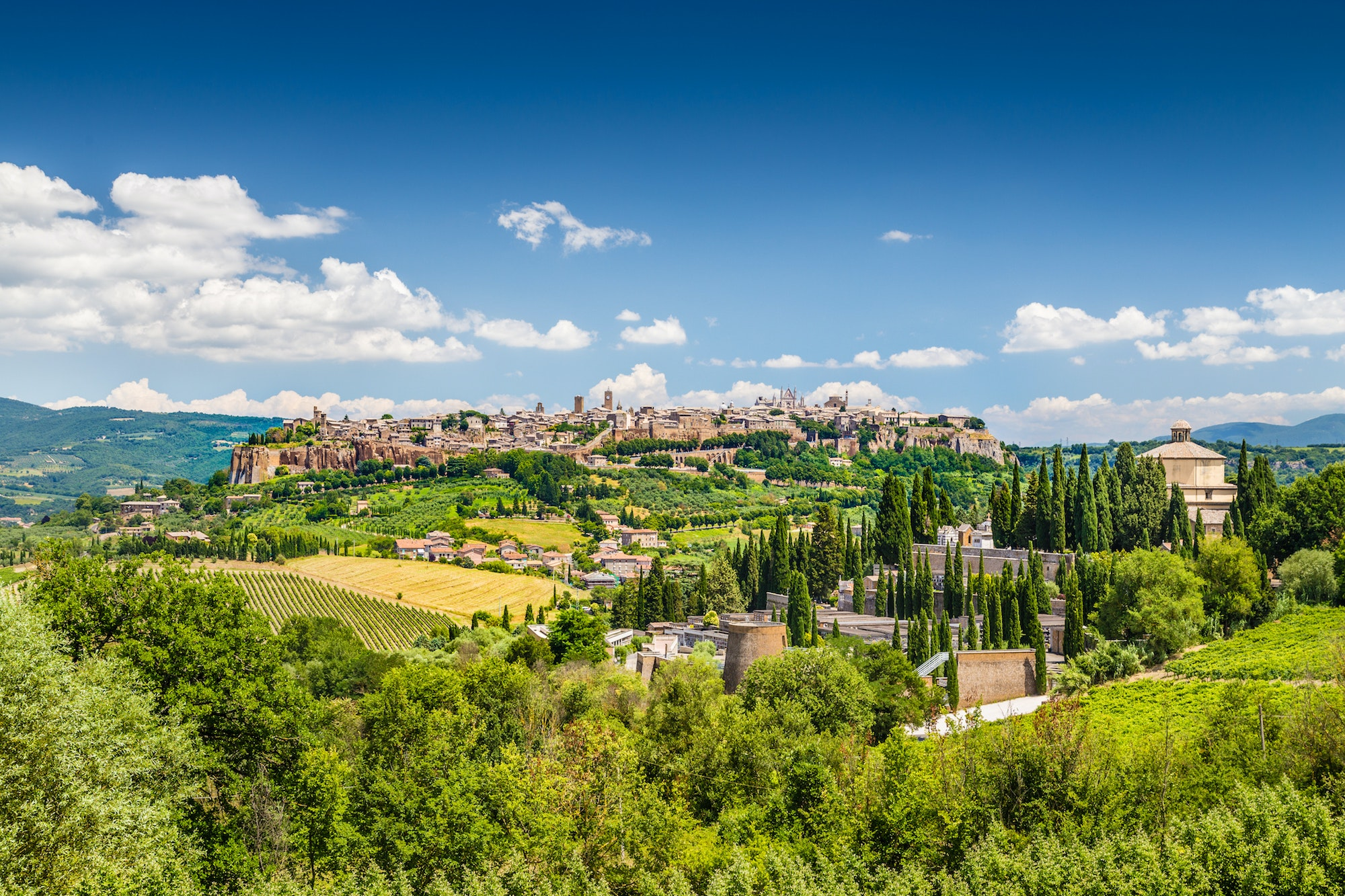 Orvieto is a small city perched on a volcanic stone cliff in Umbria, Italy.