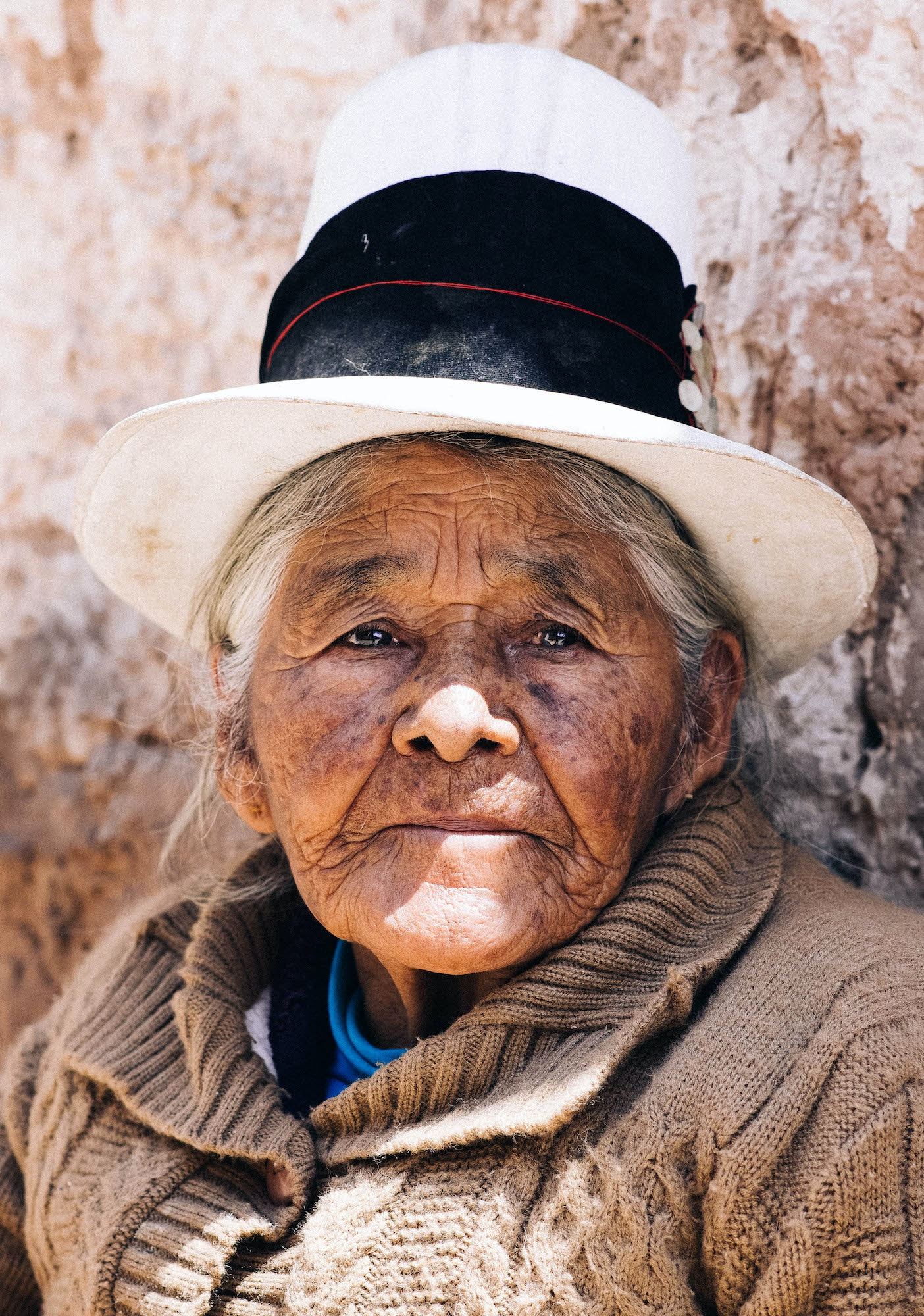 Local women wearing traditional top hats caught Laucht's eye while traveling in Peru.