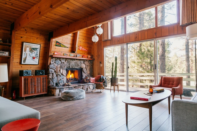 Cozy up around the fireplace at this Big Bear cabin.