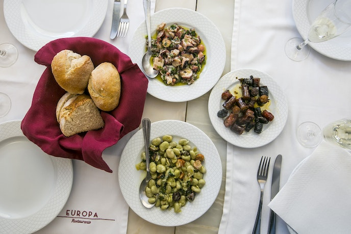 At classic spot Cervejaria Europa, in the Campo de Ourique district, expect your table to be covered with traditional salads.