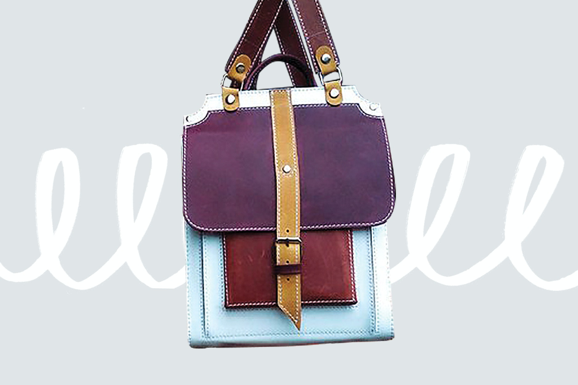 Pack your travel goodies in a multi-colored leather bag.