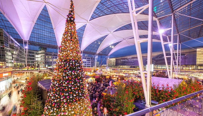 Travelers at Munich Airport will be greeted by hundreds of real pine trees, a Christmas market, and two ice rinks.