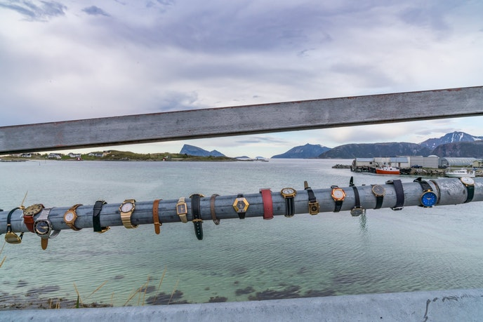 The bridge to Sommarøy is decorated with watches, marking the island's unique relationship with time.